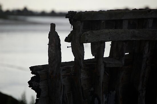 Remains of an old boat rotting away at low tide by PaulMcGuinness