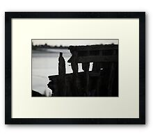 Remains of an old boat rotting away at low tide Framed Print
