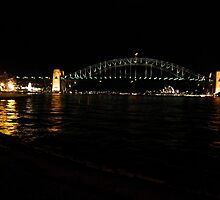 Sydney harbour bridge, Opera house and Luna park at night by Bernie Stronner