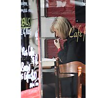 Refreshing her lipstick, while reading a book ... Photographic Print