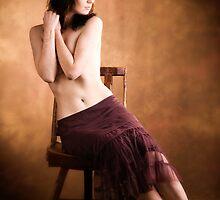 Red Headed Girl on Wooden Chair by Maxoperandi