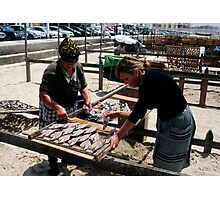 The Ladies Of Nazaré Tend Their Fish Photographic Print