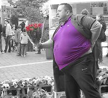 Fat bloke with flowers by Rob Hawkins