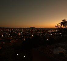 Sundown in Windhoek Namibia by Warren. A. Williams