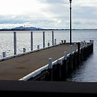 Pier at the waterfront. by Zoe B