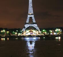 Eiffel Tower at midnight with reflection by Daniel Knox