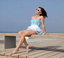Beautiful woman relaxing on bench by peterheaven