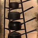 Antique iron saucepans by Deb Gibbons