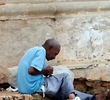 Rolling a smoke, disused church, Trinidad, Cuba by buttonpresser