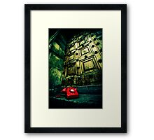 Retro red phone outside a spooky wooden door Framed Print