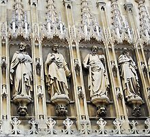 Statues over the entrance to Gloucester Cathedral, UK by buttonpresser