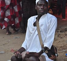 Disabled man begging in the souk-Juba, Southern Sudan by Compassion
