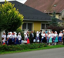 Gathering in traditional rural folk costumes on the street in Hungary by ambrusz