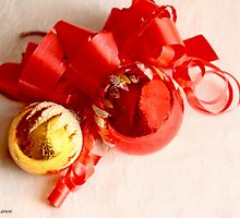 Red and gold Christmas balls on white damask linen by pogomcl