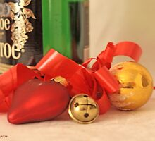 Gold ball,  red satin heart, Russian champagn bottle and red ribbon with a jingle bell on white damask by pogomcl