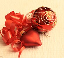 Red Christmas ball with red satin glass heart with red ribbon on white damask linen by pogomcl
