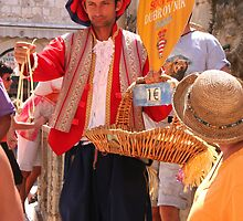 Street Vendor in Old Dubrovnik by Laurel Talabere