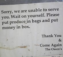 SIGN AT A PRODUCE STAND by Pauline Evans