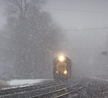 Outbound Train in the snow in Berea, Ohio by Henry Plumley