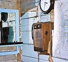 The old wall telephone with a crank handle by Fineli