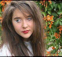 Gen infront of Orange Flowers  by Seone Harris-Nair