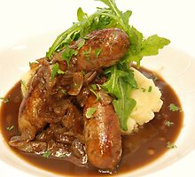 Pork and fennel sausages with herbed mash and caramelised onion gravy by Nino Ulaan