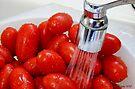 Washing Grape Tomatoes by Jan  Tribe