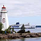 Tobermory Lighthouse and the MS Chi-Cheemaun Ferry by jules572