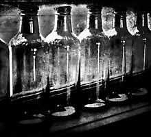 Bottles on the window sill in B&W by Deb Gibbons