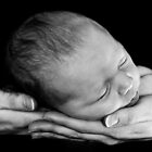 A mother's arms are made of tenderness... by Emma Collins