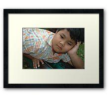 little boy get bored Framed Print