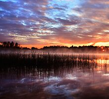 Sunset reflection on lake by Romeo Koitmäe