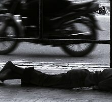 homeless at the bus-stop by Sameer R.K.