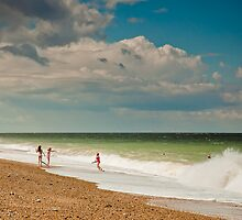 Fun in the sea at Cley by Zoe Power
