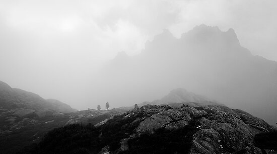 Bushwalkers dwarfed by Mount Pegasus in the mist by Michael Gay