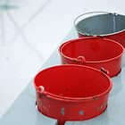 red buckets on a rainy day by 77degrees