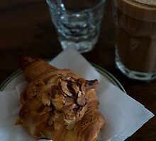 croissant and coffee by Skye Hohmann