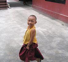 dancing by. young tibetan monk - india by tim buckley | bodhiimages photography