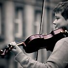 Young violinist  by Sajeev C Pillai