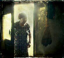 Woman in doorway by Morten Kristoffersen
