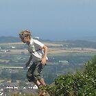 boy jumping off rock by caroline1983