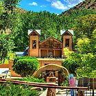 Artist painting at Santuario de Chimayó Church in New Mexico by Diana Graves Photography
