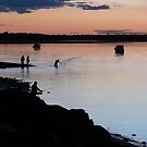 Casting a net at Burrum Heads  by PhotosByG