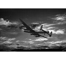 Lancaster Bomber On Night Raid Photographic Print