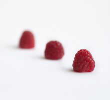 Three raspberries by Alice Kent
