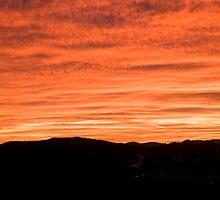 Sunset over suburb of Ljubljana by Ian Middleton