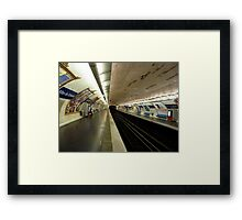 The next train in 3 minutes Framed Print