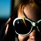 Young Lady in Sunglasses by Joe Randeen
