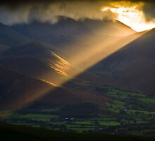 Golden rays on distant fells by Shaun Whiteman