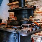 Irons Heating On Stove by Susan Savad